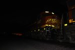 The sun has set on BNSF 6637 and just leaves a faint glow as she waits to push a eastbound Z as the rearmost DPU.